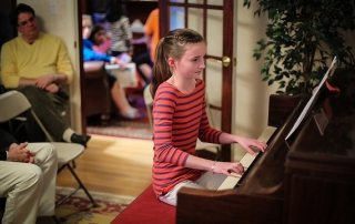 Girl at piano by adwriter