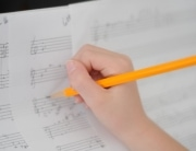 Student hand composing_Larger